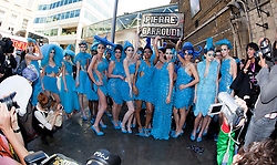 © licensed to London News Pictures. London, UK  08/06/2011. 19 models wearing turquoise dresses designed by Pierre Garroudi hit Central London and London Underground in a flashmob today, Wed. 8 June.  Please see special instructions for usage rates. Photo credit should read Bettina Strenske/LNP