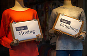 Positive messages during Covid coronavirus lockdown held by mannequins in shop window, UK - Keep Moving, Keep Laughing