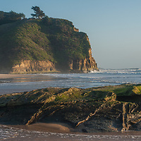 Waves wash ashore at Pomponio State Beach on the California coast near Pescadero, California.