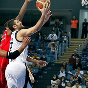 Fenerbahce Ulker's Omer ONAN (R) during their Turkish Basketball league match Fenerbahce Ulker between Pinar Karsiyaka at Sinan Erdem Arena in Istanbul, Turkey, Saturday, April 09, 2011. Photo by TURKPIX