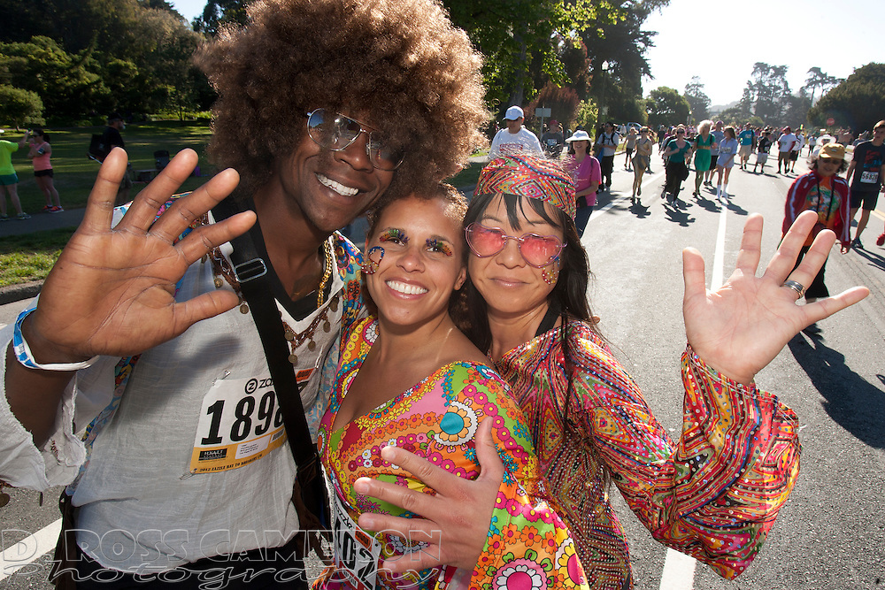 1970s hipsters Dray Gardner, from left, Melissa Baldwin and Mary Miyashita, all from Las Vegas, Nev., pose for a photograph during the 101st Bay to Breakers 12K footrace, Sunday, May 20, 2012 in San Francisco. More than 50,000 people participated in the 7.46-mile race, ranging from elite runners to those who ran in costume -- or nothing at all. (Photo by D. Ross Cameron)