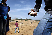 Palestinian youths throw stones at Israeli tanks during the clash between Israeli tanks and the youths in Beit Lahia in Gaza Strip, the border city of three Jewish settlements of Eily Senai. The IDF tanks entered the Gaza Strip following the attacks carried out by Hamas militant on Israeli civilians the day before.