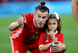 Wales' Gareth Bale with his daughter Alba Violet before the League B, Group four match at Cardiff City Stadium.