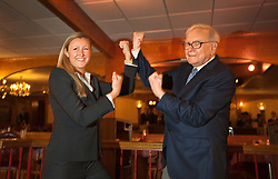 Warren Buffett poses with business students from universities around the country after at lunch at Piccolo Pete's Restaurant in Omaha, Neb., Nov. 11, 2011. Here, Buffett poses with Adrianna Stasiuk, 25, second-year M.B.A. student at the University of Notre Dame.