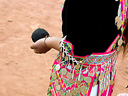 White Hmong girl holding a cloth ball for playing the ball throwing game of  'pov pob' at Ban Nakhao Hmong New Year festival, Houaphan province, Lao PDR. 'Pov pob' is a formalised courting ritual where unmarried men and women face each other in a line and toss cloth balls to one another using only one hand. The Hmong celebration of New Year is based on the lunar calendar. This important time is an opportunity to honour ancestors and spirits through offerings and rituals and to partake in games, sports, feasts, shows, bullfights and courtship. The Hmong are the third largest ethnic group in Laos. One of the most ethnically diverse countries in Southeast Asia, Laos has 49 officially recognised ethnic groups although there are many more self-identified and sub groups. These groups are distinguished by their own customs, beliefs and rituals.