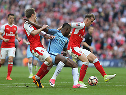 23 April 2017 FA Cup semi-final : Arsenal v Manchester City :<br /> Kelechi Iheanacho of City is stopped by Nacho Monreal (left) and Rob Holding of Arsenal.<br /> Photo: Mark Leech