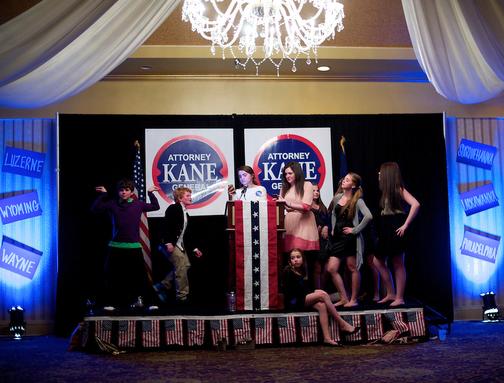 Clare Dempsey, 13, (seated) and other teen supporters of candidate for Pennsylvania Attorney General Kathleen Kane take a break from dancing atop the stage after her victory speech at a election night party at the Radisson Hotel in Scranton, Pa., on April 24, 2012.  Republican presidential primaries in Connecticut, Delaware, New York, Pennsylvania, and Rhode Island also took place.