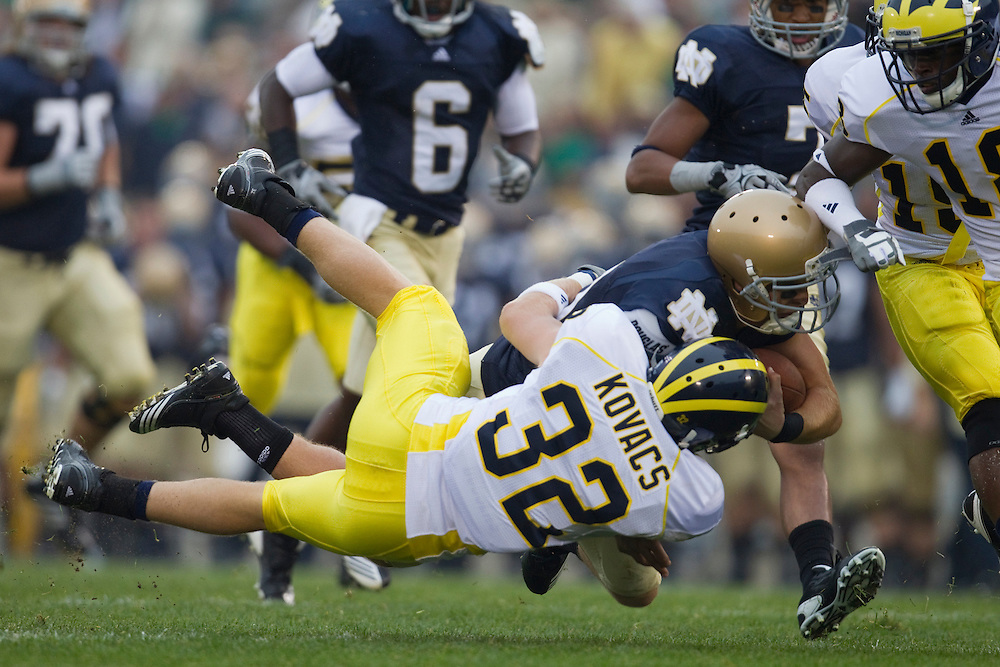 Michigan safety Jordan Kovacs (#32) makes tackle during NCAA football game between the Notre Dame Fighting Irish and the Michigan Wolverines.  Michigan defeated Notre Dame 28-24 in game at Notre Dame Stadium in South Bend, Indiana.