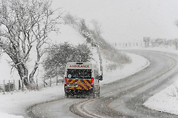 © Licensed to London News Pictures. 29/12/2020. Llanfihangel Nant Melan, Powys, Wales, UK. A ambulance drives through winter weather on the A44 road near Llanfihangel Nant Melan in Powys, Wales, UK. Photo credit: Graham M. Lawrence/LNP