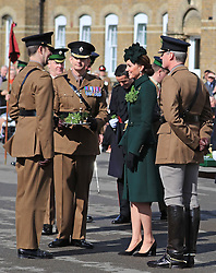 The Duchess of Cambridge attends the St Patrick's Day parade at Cavalry Barracks in Hounslow, to present shamrock to officers and guardsmen of 1st Battalion the Irish Guards.