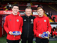 Chris Wilder manager of Sheffield Utd presents David Parkhouse with his U17 Irish cap and Shea Gordon with his U19 Irish cap during the English League One match at Bramall Lane Stadium, Sheffield. Picture date: December 10th, 2016. Pic Simon Bellis/Sportimage