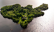 Innisfallen island on Lough Lein, Killarney where St. Fionan founded a monastery in the 12th century. This is where the Annals of Innisfallen, second only to The Book of Kells for important Irish history facts and now located in the Bodlelian Library in Oxford, England.<br /> Picture by Don MacMonagle