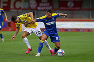 AFC Wimbledon midfielder Anthony Hartigan (8) battles with Brighton and Hove Albion midfielder Stefan Vukoje (60) during the EFL Trophy Southern Group G match between AFC Wimbledon and Brighton and Hove Albion U21 at The People's Pension Stadium, Crawley, England on 22 September 2020.