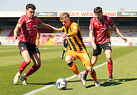 Hull City's Keane Lewis-Potter under pressure from Lincoln City's Regan Poole<br /> <br /> Photographer Rich Linley/CameraSport<br /> <br /> The EFL Sky Bet League One - Lincoln City v Hull City - Saturday 24th April 2021 - LNER Stadium - Lincoln<br /> <br /> World Copyright © 2021 CameraSport. All rights reserved. 43 Linden Ave. Countesthorpe. Leicester. England. LE8 5PG - Tel: +44 (0) 116 277 4147 - admin@camerasport.com - www.camerasport.com