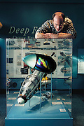 David Barrett, who constructed the original RoboTuna at the Massachusetts Institute of Technology, looks down at his creation, which now is displayed in an exhibit case at the Hart Nautical Museum at MIT, Cambridge, MA.