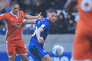 Callum Camps shields the ball  during the EFL Sky Bet League 1 match between Rochdale and Shrewsbury Town at Spotland, Rochdale, England on 9 March 2019.
