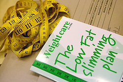 Tape measure and slimming book,