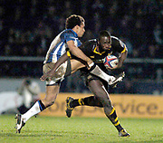 2004/05 Zurich Premiership, London Wasps vs Bath. Causeway Stadium, High Wycombe, ENGLAND:<br />Baths Andy Higgins gets a tackle in on Wasps Ayoola Eringle<br />Photo  Peter Spurrier. <br />email images@intersport-images