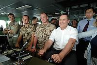 """25 SEP 2006, GOLF VON TADJURA/DJIBOUTI:<br /> Franz Josef Jung (R), CDU, Bundesverteidigungsminister, am Ruder, auf der Bruecke der Fregatte """"Schleswig-Holstein"""", die als Flaggschiff Teil des deutschen Marinekontingents der OPERATION ENDURING FREEDOM ist und im Seegebiet am Horn von Afrika operiert,  Djibouti<br /> IMAGE: 20060925-01-003<br /> KEYWORDS: Dschibuti, Bundeswehr, Marine, Soldat, Soldaten, Steuer, Afrika, Africa"""