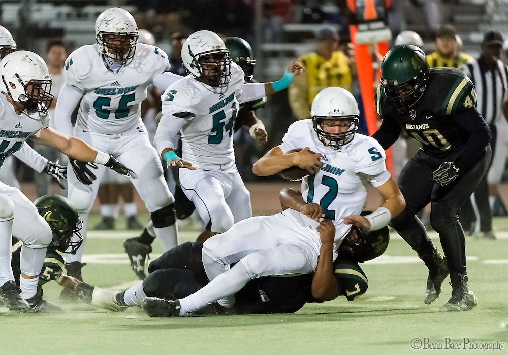 Sheldon High School Husky Chancellor Lachapelle (12), is tackled during the second quarter as the Monterey Trail Mustangs host the Sheldon High School Huskies Friday Sep 23, 2016.<br /> photo by Brian Baer