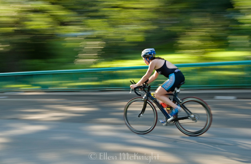 Female cyclist competing in the New York Triathlon in Riverside Park, New York City