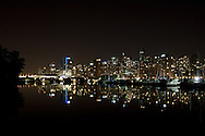 Downtown Vancouver reflected at night in the water of Coal Harbour from Stanley Park