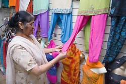 Older woman shopping for new clothes,
