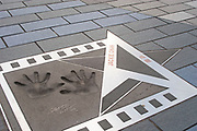 The handprints of international martial arts movie star Jackie Chan in Hong Kong, China. Printed into concrete on the walkway opposite Hong Kong Island in Kowloon. Jack Chan, aside from being an internationally reknowned actor, is a local hero in Hong Kong.