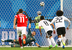 June 19, 2018 - Saint Petersburg, Russia - Igor Akinfeev of the Russia national football team vie for the ball during the 2018 FIFA World Cup match, first stage - Group A between Russia and Egypt at Saint Petersburg Stadium on June 19, 2018 in St. Petersburg, Russia. (Credit Image: © Igor Russak/NurPhoto via ZUMA Press)