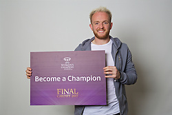 "CARDIFF, WALES - Monday, November 7, 2016: Wales' Jonathan Williams holds up a board ""Become a Champion"" to encourage people to become volunteers for the 2017 UEFA Champions League Final in Cardiff. (Pic by David Rawcliffe/Propaganda)"