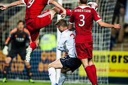 Falkirk's Rory Loy between Aberdeen's Vernon and Robertson. Falkirk 0 v 5 Aberdeen, the third round of the Scottish League Cup.<br /> ©Michael Schofield.