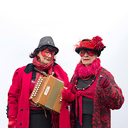 Portrait of members of Oxblood Molly Dancers at A Day of Dance, the largest annual gathering of Molly dancers in the UK in Ely on 27th January 2018. Molly dancing is a form of English Morris dance and is one of the traditional dances from the fens of East Anglia. It traditionally only appeared during the depths of winter as a means of earning some money when the land was frozen or waterlogged and could not be worked