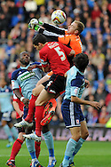 Luke Steel, the Boro keeper punches clear from Mark Hudson, the Cardiff city capt (5). NPower Championship, Cardiff city v Middlesbrough at the Cardiff city stadium in Cardiff in South Wales on Saturday 17th November 2012.  pic by Andrew Orchard, Andrew Orchard sports photography,