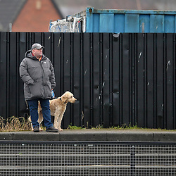 TELFORD COPYRIGHT MIKE SHERIDAN A Farsley fan with his dog during the Vanarama Conference North fixture between AFC Telford United and Farsley Celtic at The Citadel on Saturday, January 25, 2020.<br /> <br /> Picture credit: Mike Sheridan/Ultrapress<br /> <br /> MS201920-042