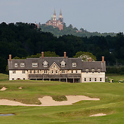 View of the Erin Hills Golf Course clubhouse from the 18th hole with Holy Hill Catholic Monastery looming in the background. Please send licensing requests to legal@toddbigelowphotography.com