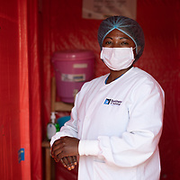 Bernadine Nzumwa, a nurse at a Butembo clinic in Congo, scrubs up using the Ebola protocol and full PPE. The clinic was part of a network of clinics supported by IMA to respond to and recover from Ebola.