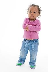 Portrait of a little girl looking grumpy in the studio,
