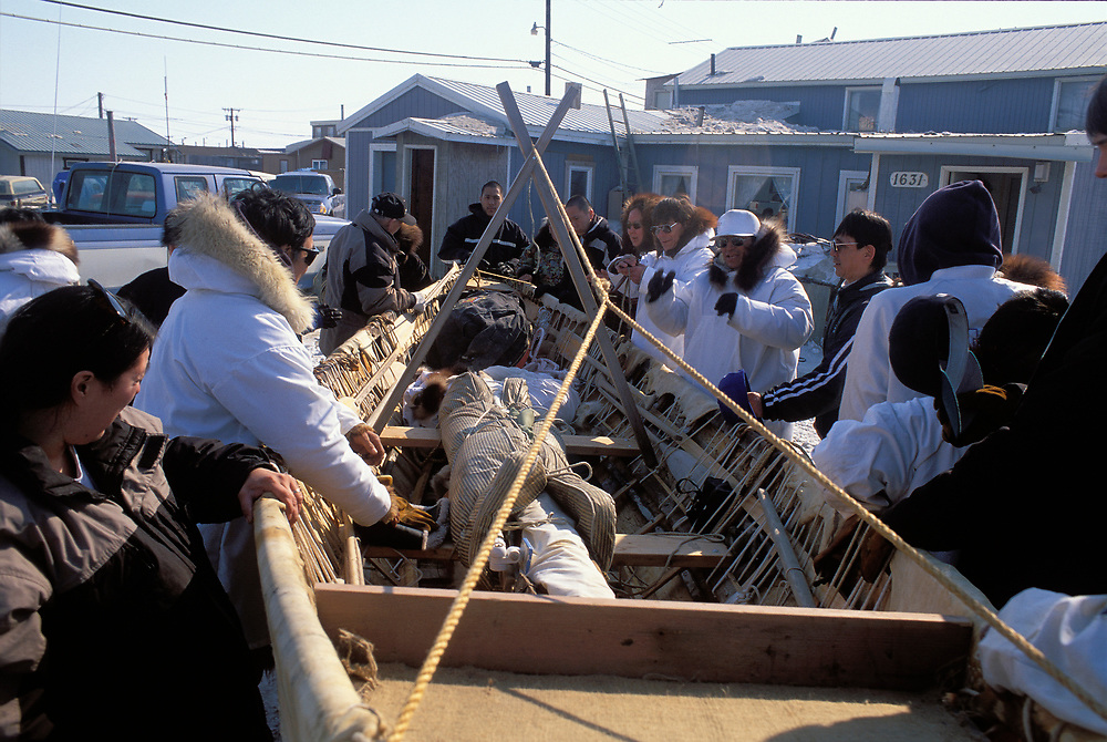 Barrow, Alaska, A crew of native whalers and their families share a moment of prayer before they set off onto the sea ice to hunt for bowhead whales
