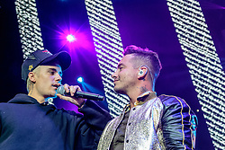 LOS ANGELES, CA - JAN 24: Colombian reggaeton singer J Balvin performs onstage with Canadian singer, songwriter, and record producer Justin Bieber during Calibash 2016 held at Staples Center on January 24, 2016 in Los Angeles, California. CALIBASH 2016, hosted by KXOL Mega 96.3FM, La Musica and produced by AEG Live and Latin Events. Byline, credit, TV usage, web usage or linkback must read SILVEXPHOTO.COM. Failure to byline