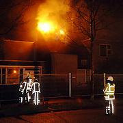 NLD/Huizen/20060310 - Uitslaande brand leegstaand pand de Boketorren Hermelijn Huizen