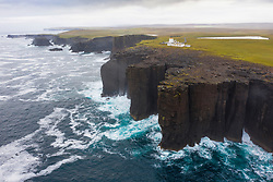 Dramatic cliffs  and lighthouse on coast at Eshaness at Northmavine , north mainland of Shetland Islands, Scotland, UK