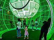 "23 NOVEMBER 2018 - BANGKOK, THAILAND:  A child walks through a lit ball, that represents an ornament, in the ""World of Happiness,"" the Christmas display at Central World, a large mall in Bangkok. Although Thailand is an overwhelmingly Buddhist country, the commercial aspects of Christmas are widely observed, especially in Thailand's urban areas, which have large concentrations of Europeans and Americans.    PHOTO BY JACK KURTZ"