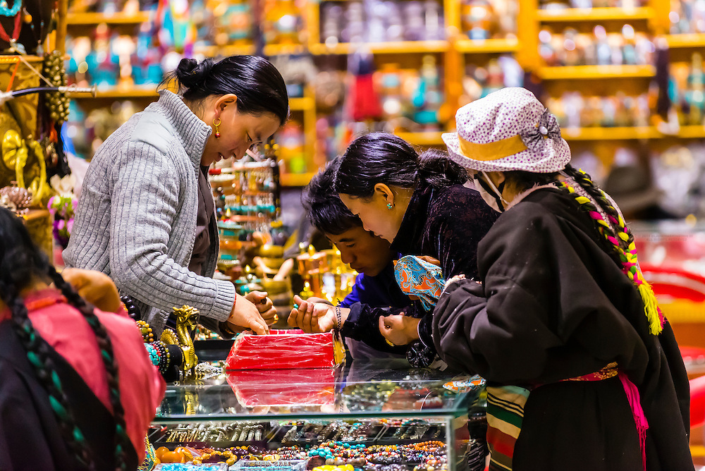 Tibetans shopping, Barkhor Square, Lhasa, Tibet (Xizang), China.