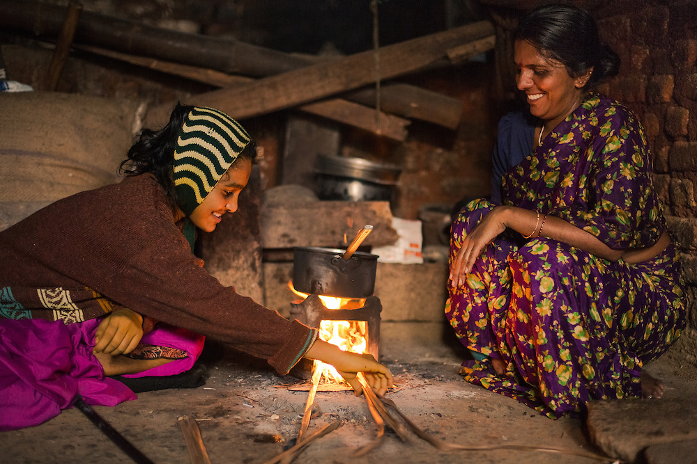 CAPTION: Sheela has a small business making food and drinks for local schoolchildren. Through this, she is able to support her daughter Nandini, who has a learning disability. She plans to soon take advantage of a loan provided through the Chamkol programme's Revolving Fund Scheme in order to upgrade her shop stock. Here, we see Nandini helping her mother to make tea to sell. LOCATION: Alduru (village), Santhemarahalli (hobli), Chamrajnagar (district), Karnataka (state), India. INDIVIDUAL(S) PHOTOGRAPHED: Nandini (left) and Sheela (right).