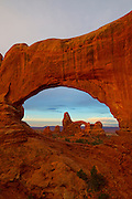 The North Window frames Turret Arch, one of about 2,000 arches located in Arches National Park, Utah.