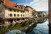 View of the Auberge du Lyonnais Hôtel/Restaurant and other buildings along the incredible reflective waters of the Thiou Canal, old town section of Annecy, France.
