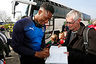 Wimbledon defender Paul Kalambayi (30) signing autographs during the EFL Sky Bet League 1 match between Scunthorpe United and AFC Wimbledon at Glanford Park, Scunthorpe, England on 30 March 2019.