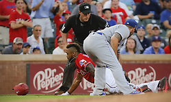 May 25, 2018 - Arlington, TX, USA - Texas Rangers center fielder Delino DeShields (3) triples in the third inning as Kansas City Royals third baseman Mike Moustakas (8) cannot make the tag in time as the Kansas City Royals play the Texas Rangers at Globe Life Park in Arlington, Texas, Friday, May 25, 2018. (Credit Image: © Rodger Mallison/TNS via ZUMA Wire)