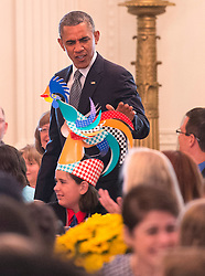 President Barack Obama looks at a child's hat as he arrives at the Kids' State Dinner in the East Room at the White House on July 18, 2014 in Washington, DC, USA. The event recognizes winners of a nationwide recipe challenge to promote healthy lunches in schools. Photo by Kevin Dietsch/Pool/ABACAPRESS.COM  | 457873_004 Washington Etats-Unis United States
