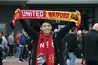 Football - 2018 / 2019 Premier League - Manchester United vs. Watford<br /> <br /> A United fan poses with his matchday scarf, at Old Trafford.<br /> <br /> COLORSPORT/ALAN MARTIN